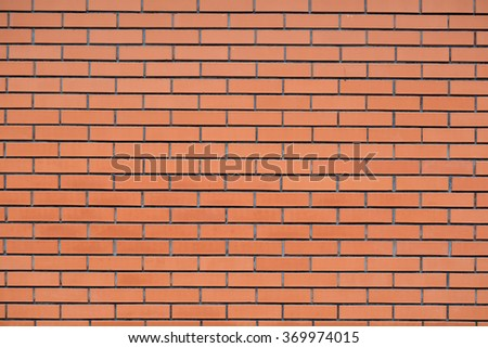 The texture of the stone wall. Stone in the section. Limestone. Granite. Marble. Coquina. Background. Stone floor. Pebbles. Macadam. New clay brick. Red brick. Beautiful masonry. - stock photo
