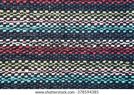 The texture of the weave woolen threads of black, white, blue, red - stock photo