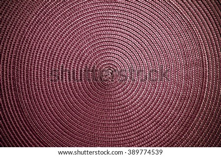 The texture of woven straw. The circular structure. Abstract woven texture. - stock photo