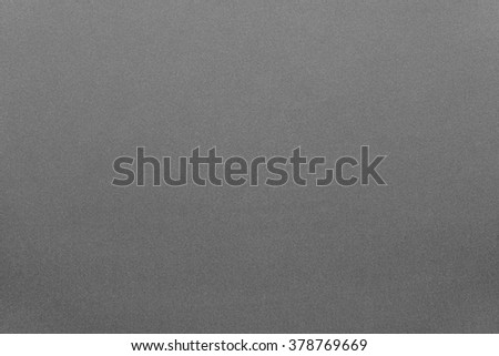 the textured background from textile material or from fabric of gray color with abstract design of texture