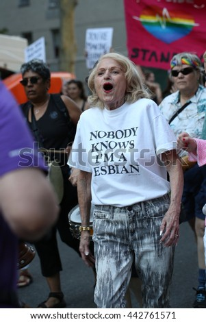 "The 24th Annual NYC Dyke March. June 25, 2016. New York City, New York.  Washington Square Park.  Older woman wears shirt that  says ""Nobody Knows that I am lesbian."""