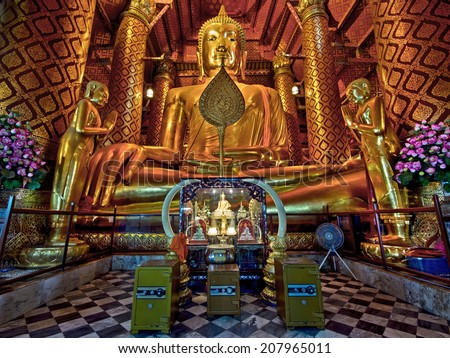 The 14th century Buddha statue at the Wat Phanan Choeng temple in Ayutthaya, the former capital of Thailand. - stock photo