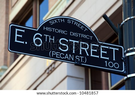 The 6th Street road sign.  6th Street is the party strip in Austin, Texas.  Parties, Live Bands, Bars, Clubs, ... its all happening on 6th Street. - stock photo