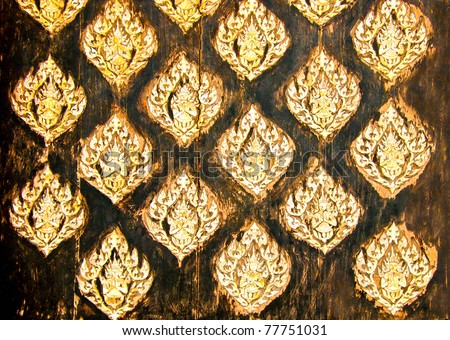 The Thai art carved pearl shell on old wood