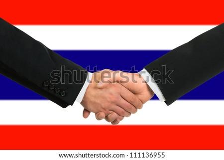 The Thai flag and business handshake - stock photo