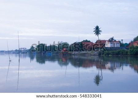 The Thai middle region style house along the river in early morning, Uthaithani Thailand