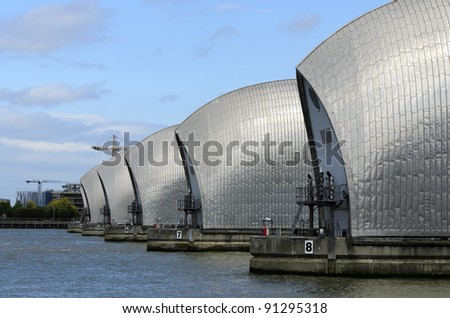 The Thames Barrier in London England. The Thames Barrier is the world's second largest movable flood barrier - stock photo