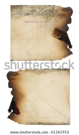 The the front and back of a grungy, yellowing, fire-damaged envelope.  Envelope is soot stained and the right edge is completely burned away. Isolated on white.