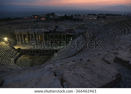 The theatre at the Hierapolis site shot after sunset. It was an ancient Greek city located on the hot springs in modern day Pamukkale, Turkey.  - stock photo