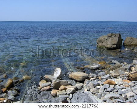 The thin rocky veins leaving under water - stock photo