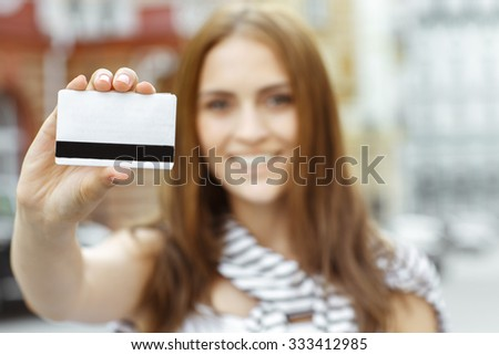 The thing you need for shopping. Selective focus shot of a young smiling brunette shopper showing credit card