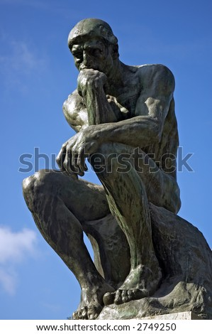 The Thinker(1880-1882) by Auguste Rodin, sits outside the Rodin museum in the sculpture garden, Paris - stock photo