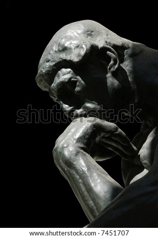 The Thinker, famous statue by Auguste Rodin, isolated on black - stock photo