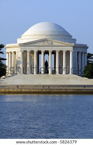The Thomas Jefferson Memorial photographed across the Tidal Basin shortly after dawn. The memorial, in Washington, DC, is dedicated to Thomas Jefferson, the third president of the United States. - stock photo