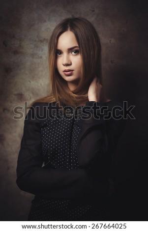 The thoughtful beautiful woman attentively looks. - stock photo