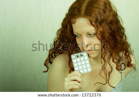 The thoughtful girl holds in a hand of a tablet and reflects on the developed situation