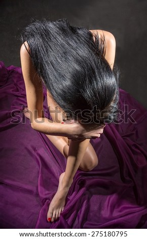 The thoughtful naked brunette  - stock photo