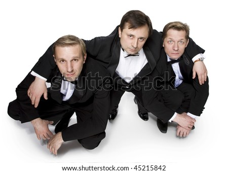 The three gentlemen in black tuxedos - stock photo
