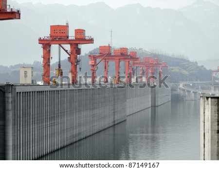 the Three Gorges Dam at Yangtze River in China in foggy ambiance - stock photo