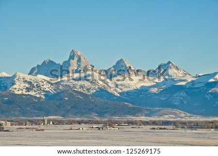 The three peaks of the Tetons as seen from the Teton Valley in Idaho. - stock photo