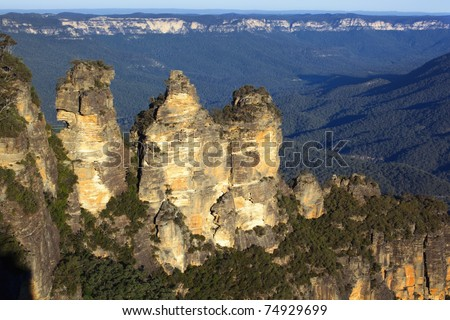 The Three Sisters, Katoomba, Blue Mountains, New South Wales, Australia.  At sunset. - stock photo