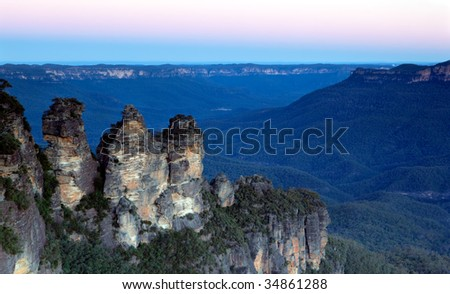The Three Sisters, Katoomba, Blue Mountains, Sydney, Australia.  Taken just after sunset.  You can see why they're called the Blue Mountains! - stock photo