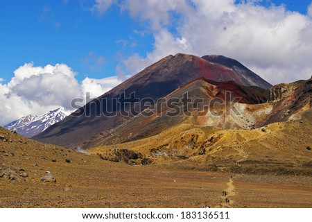 The three sisters of the Tongariro crossing standing side by side on New Zealand's north island, raked the top one day walk in New Zealand. In the center lies Mt Doom famous from The Lord of the Rings - stock photo