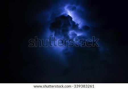 The Thunder and  lightning. The sky Blue tone. - stock photo