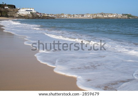 The tide coming in a Porthminster beach, St. Ives, Cornwall. - stock photo