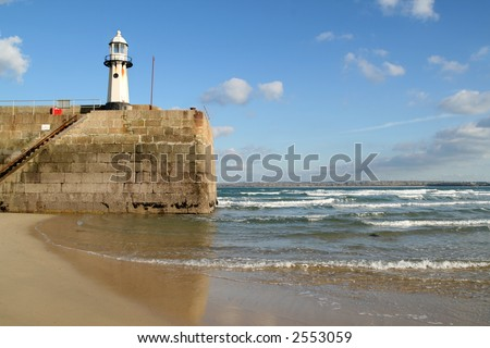 The tide coming in around the end of Smeaton's pier, St. Ives, Cornwall. - stock photo
