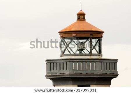 The timeless design of a historic nautical lighthouse beacon - stock photo