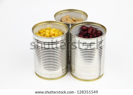 The tins with bean, red bean, corn on the white background - stock photo