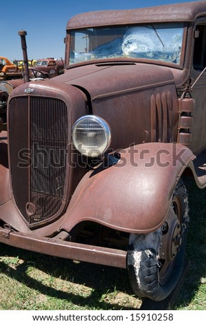 The tire on this antique truck gives a whole new meaning to the term threadbare - stock photo