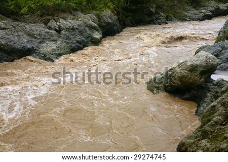 The Toachi River in Western Ecuador in flood - stock photo
