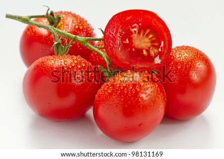 The tomatoes on white background - stock photo