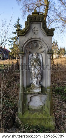 The tombstone on the gothic cemetery - stock photo