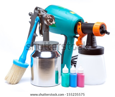 The tool for a painting of surfaces - spray gun electrical and manual mechanical - stock photo
