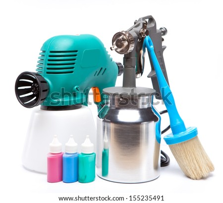 The tool for a painting of surfaces - spray gun electrical and manual mechanical and small bottles with color - stock photo