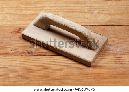 The tool, trowel, wall plaster. On a wooden board. Nobody. - stock photo