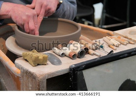 The Tools and Wheel of a Traditional Clay Potter. - stock photo