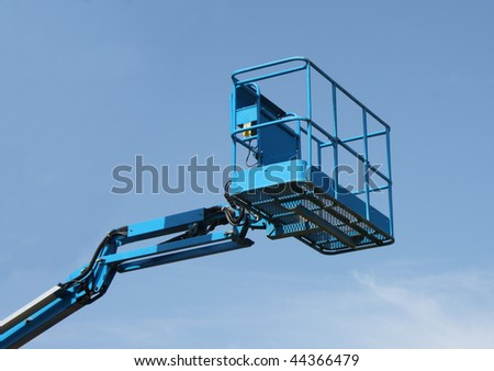 The Top of a Blue Mechanical Lift Vehicle - Cherry Picker. - stock photo