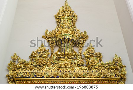 The Top of A Golden Entrance of A Temple in Thailand - stock photo