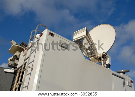 The top of a North American TV news truck. - stock photo