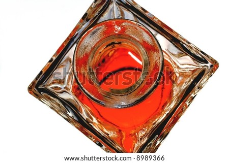 The top of an open ornate whiskey decanter. - stock photo