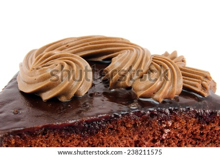 The top of chocolate cake with cream - stock photo