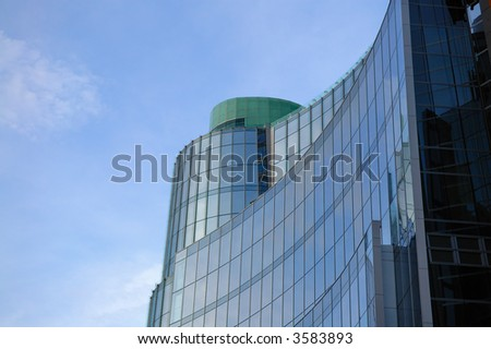 The top of office building over sky - stock photo