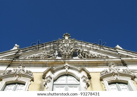 The top of the front of the ceremonial facade of the corps de logis of the Queluz national palace in Portugal - stock photo