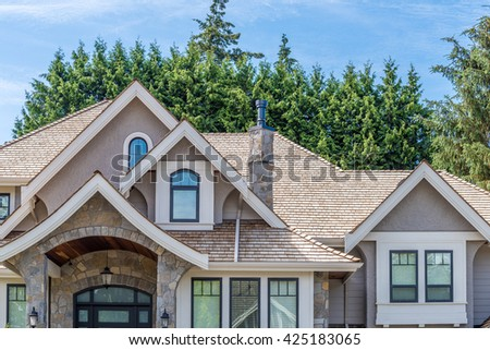 The top of the house with a nice window. - stock photo
