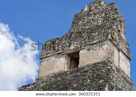 The top of the Temple I of the Maya archaeological site of Tikal in Guatemala - stock photo