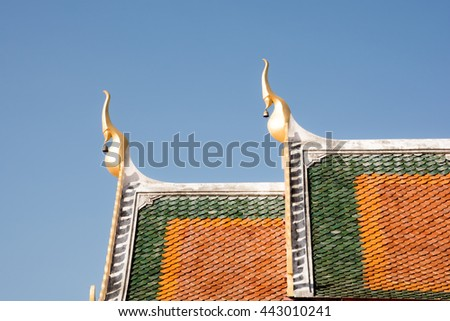 The top roof of church of buddhism ,Wat Phra That Choeng Chum, decorate Thai style - stock photo